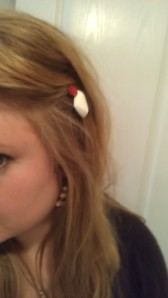 Last year, Lindsay made me the adorable hairpins which are just buttons glued to bobbi pins. She also made me the earring, but you can't see it well here.