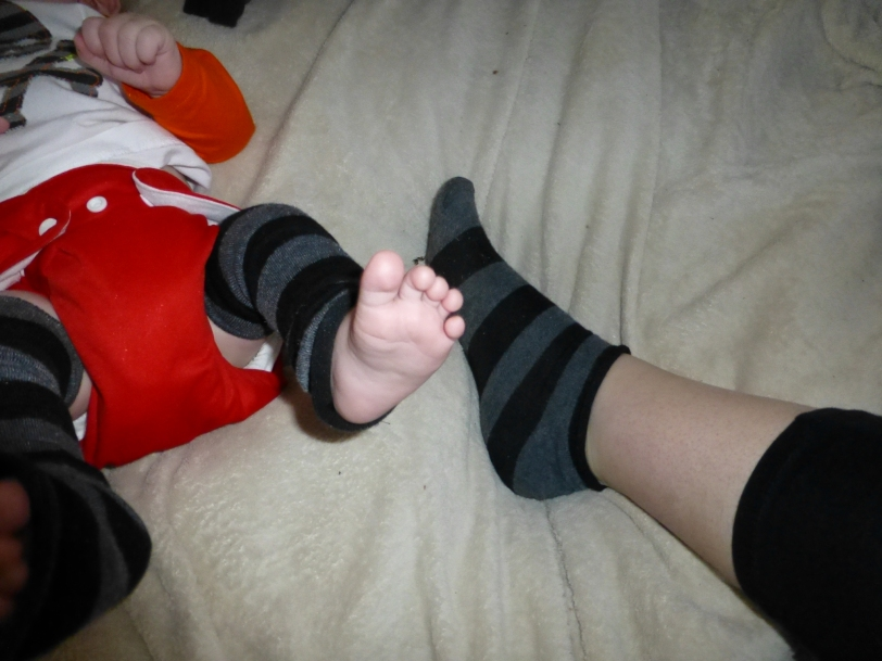 As a bonus, after you cut the socks, you have a pair of baby leg warmers AND a nice new matching pair of anklets.