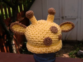 Look at how cute this giraffe hat is! She also does elephants, koala's, all sorts of creative stuff.