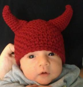And here's Leon when he was a newborn wearing the devil hat I got him. We went to a Halloween party when he was 4 weeks old. I was an angel, and he was a devil.